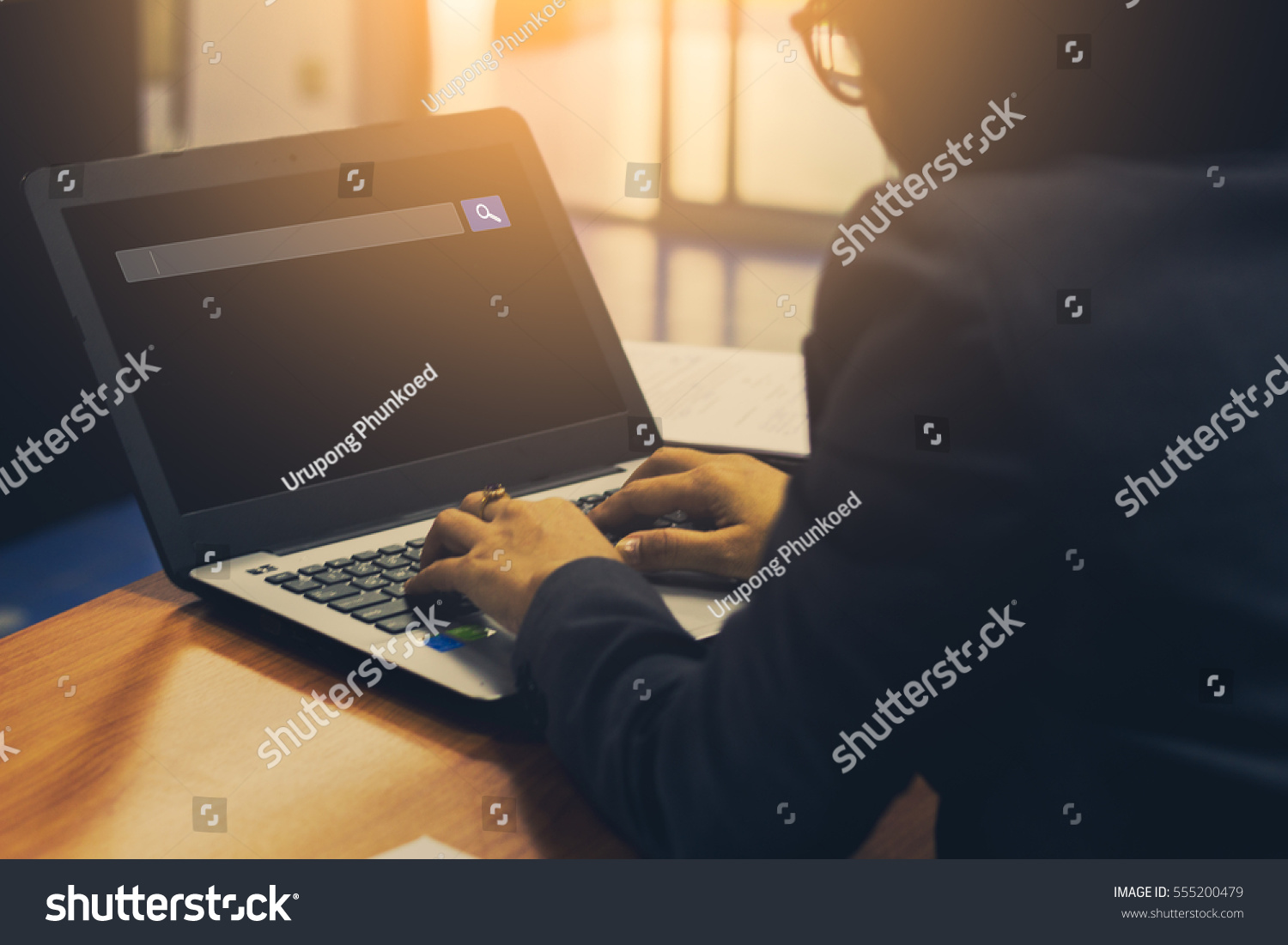 business people search web and technology concept of using internet browser on laptop computer on table  #555200479