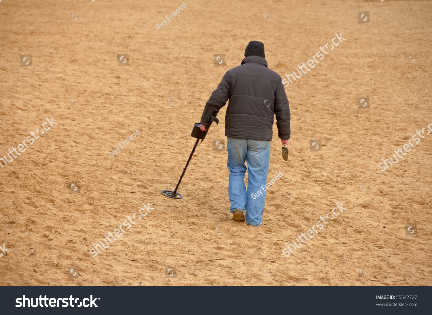 Jew Detector: Man Using Metal Detector On Sand Stock Photo 55542727