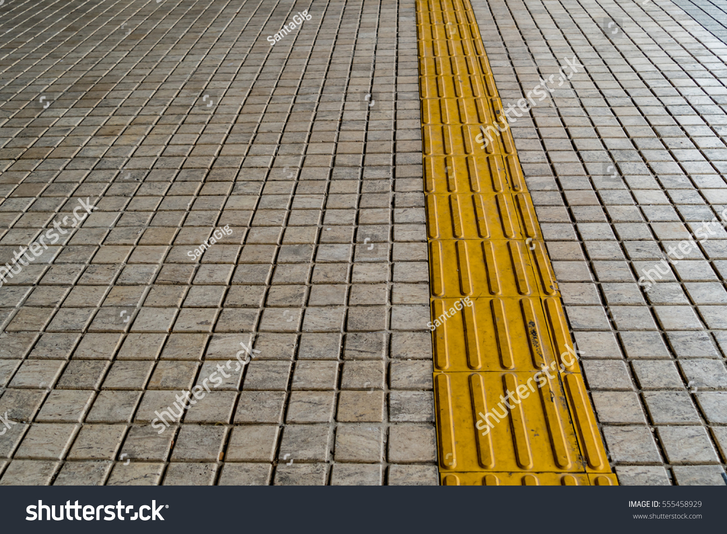 Tactile paving blind handicap on tiles stock photo 555458929 tactile paving for blind handicap on tiles pathway dailygadgetfo Image collections