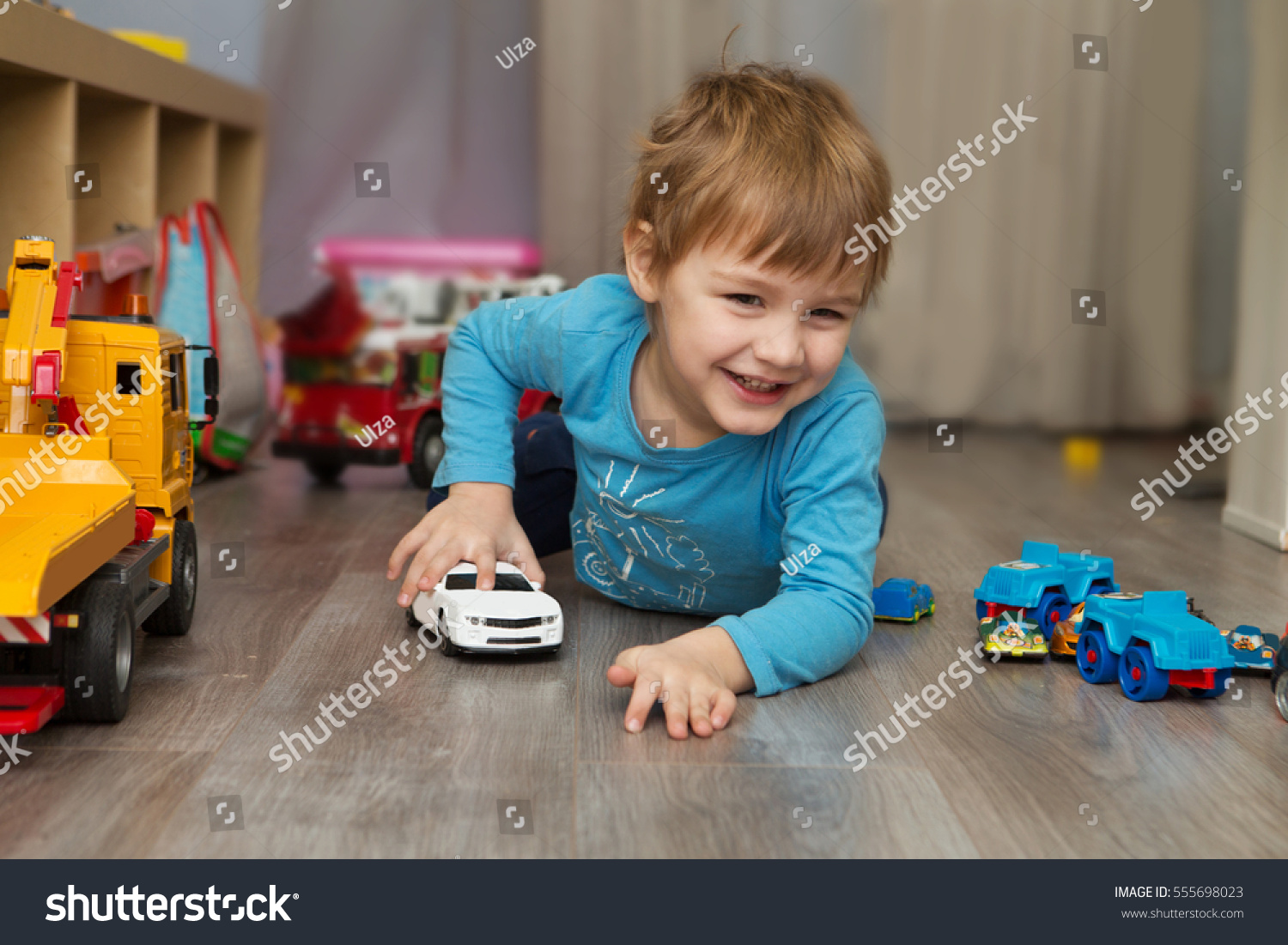 Little Boy With Toy Car : Little boy plays toy car home stock photo