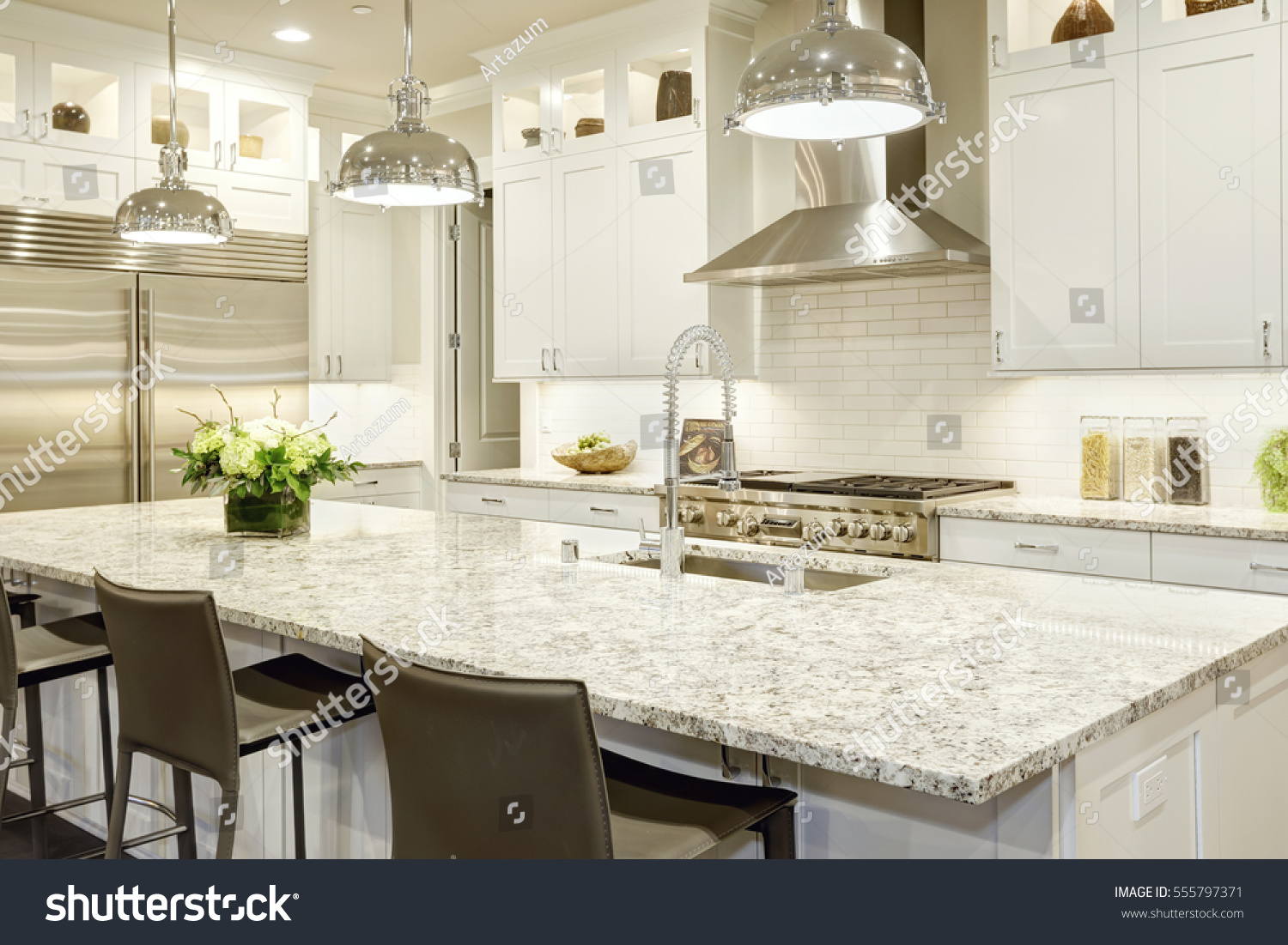 White Kitchen Design Features Large Bar Stock Photo (100% Legal ...