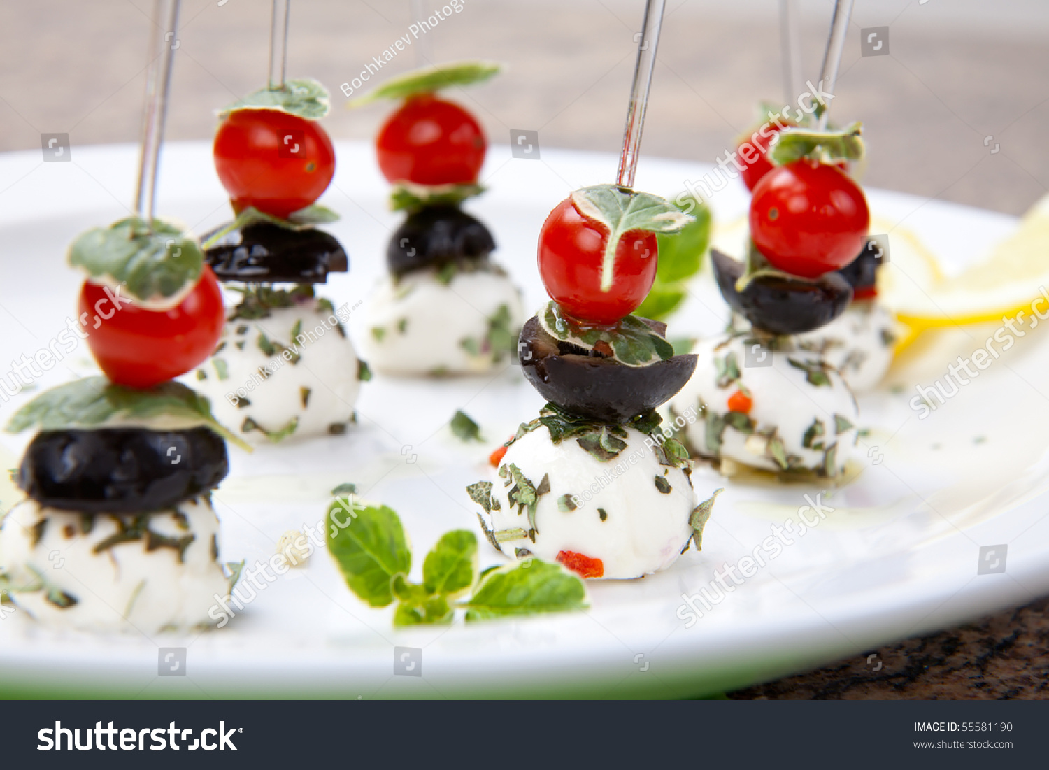Plate full delicious mozzarella cheese canapesandwiches for Mozzarella canape