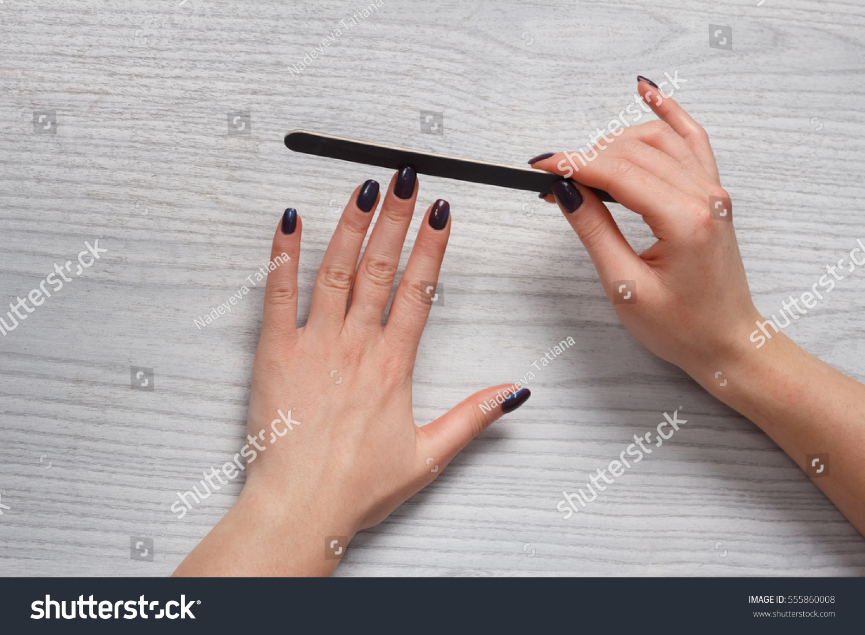 Woman Doing Nails Form Nail File Stock Photo (Royalty Free ...