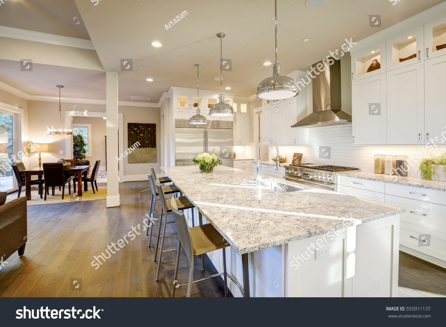 White kitchen design features large bar stock photo for Cocinas grandes modernas