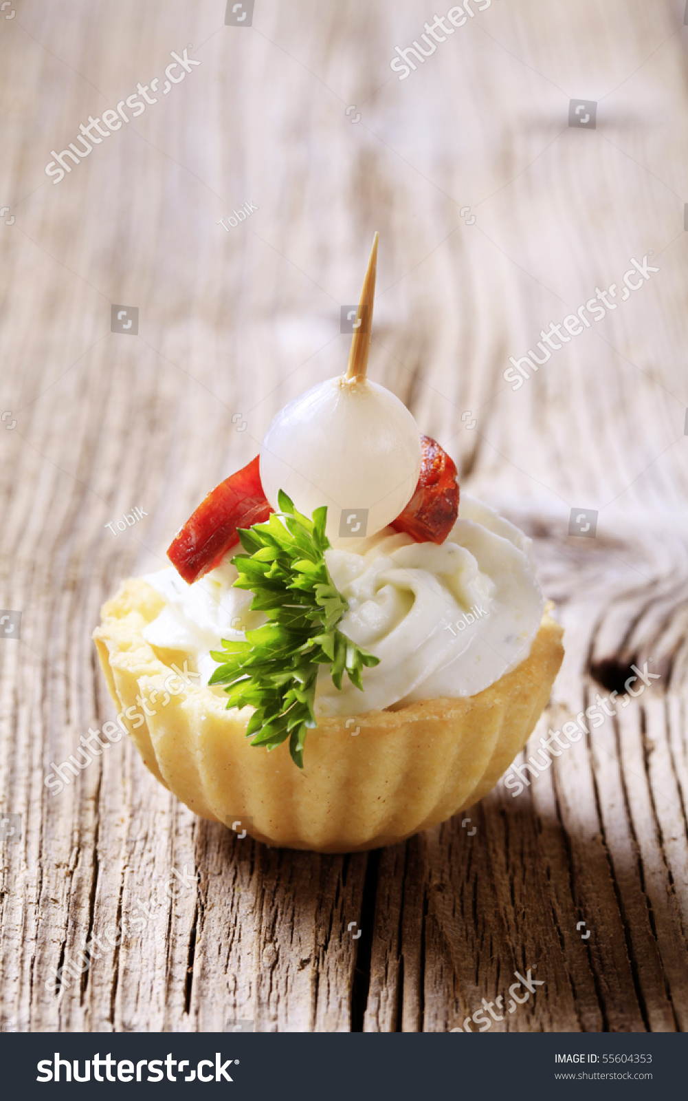 Canape tart shell with savory spread filling topped with for Canape pastry shells