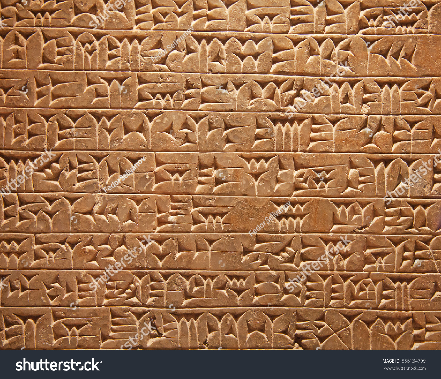 Ancient sumerian stone carving cuneiform scripting stock