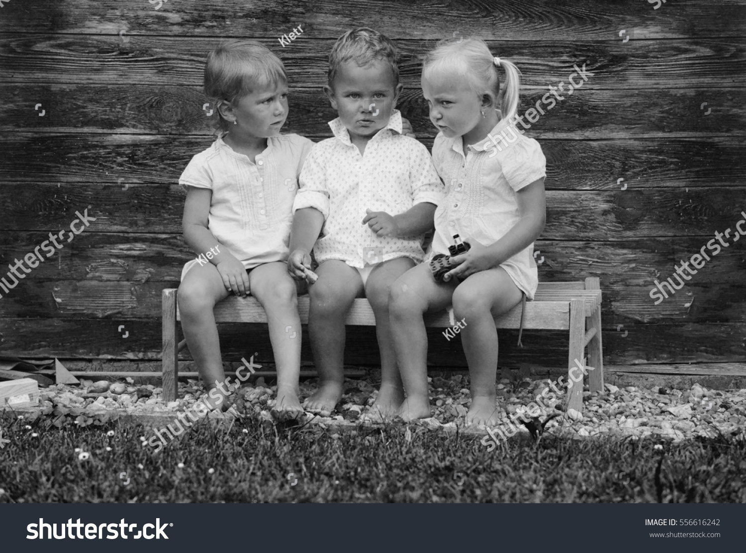 Black And White Photography Of Happy Children Talking On A Wooden Bench Little Friends Enjoying