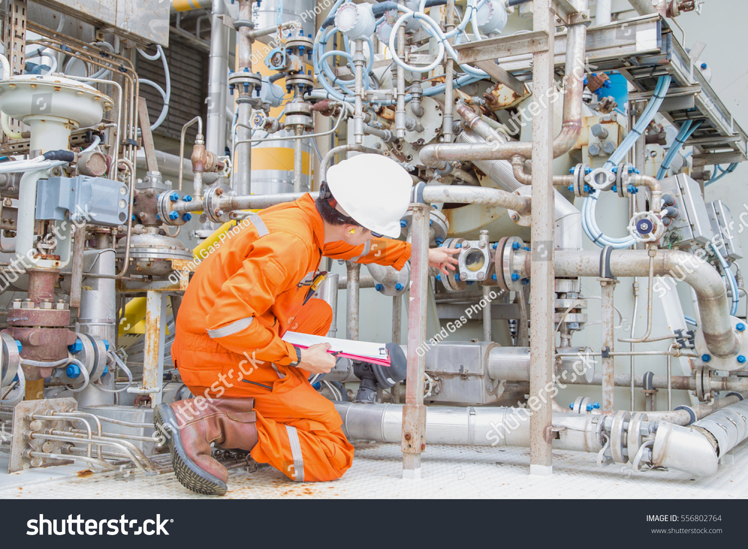 Immage Offshore Engineering : Mechanical engineer checking inspect lube oil stock photo