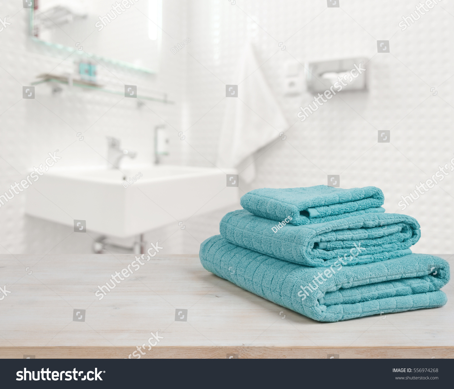 Turquoise spa towels pile on wood stock photo 556974268 for Salon turquoise