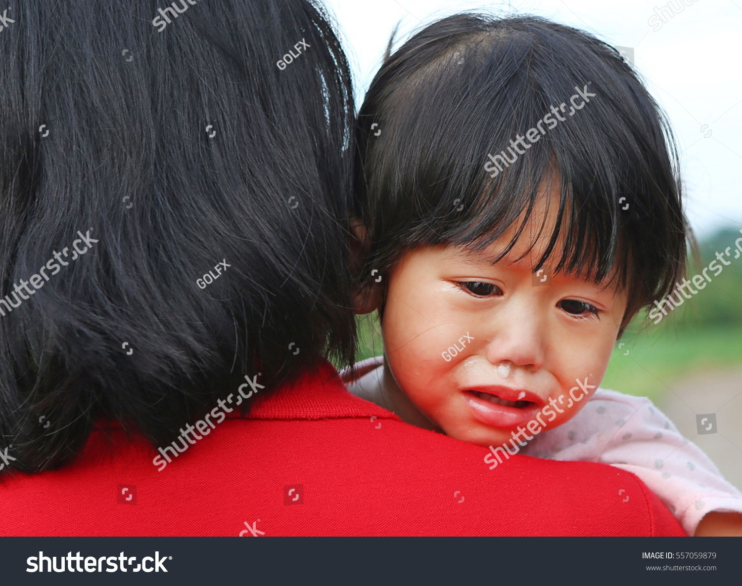 af33f0bc02dc Royalty-free Close up asian baby girl crying on hug…  557059879 ...