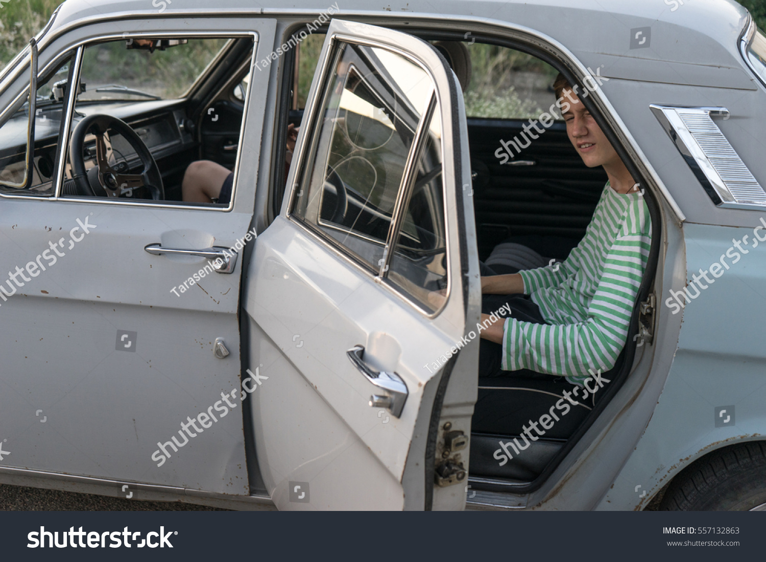 Boy Peeps Out Old Car Two Stock Photo (Download Now) 557132863 ...
