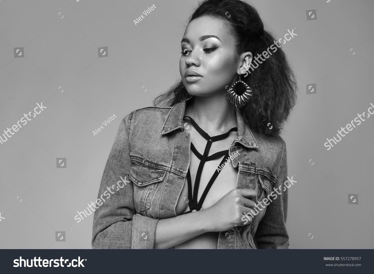 e2733a19f6ad Portrait of glamor elegant black woman model in jeans jacket posing on a  gray background in