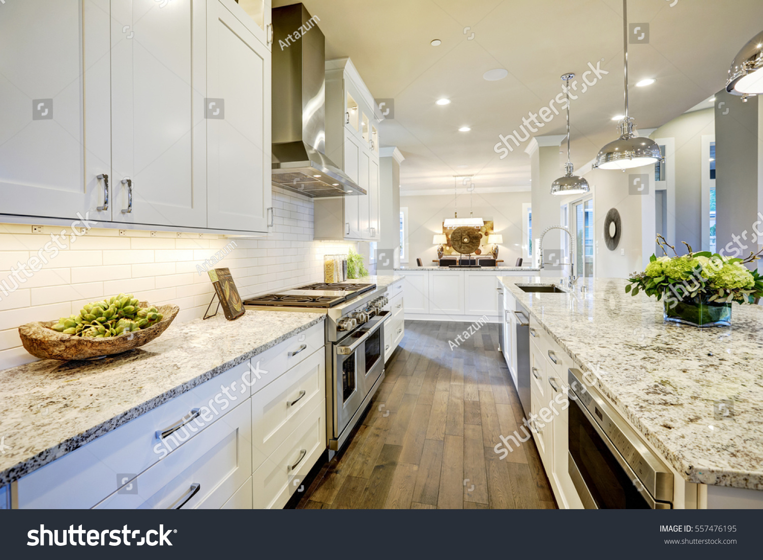 White Kitchen Design Features Large Bar Stock Photo & Image (Royalty ...