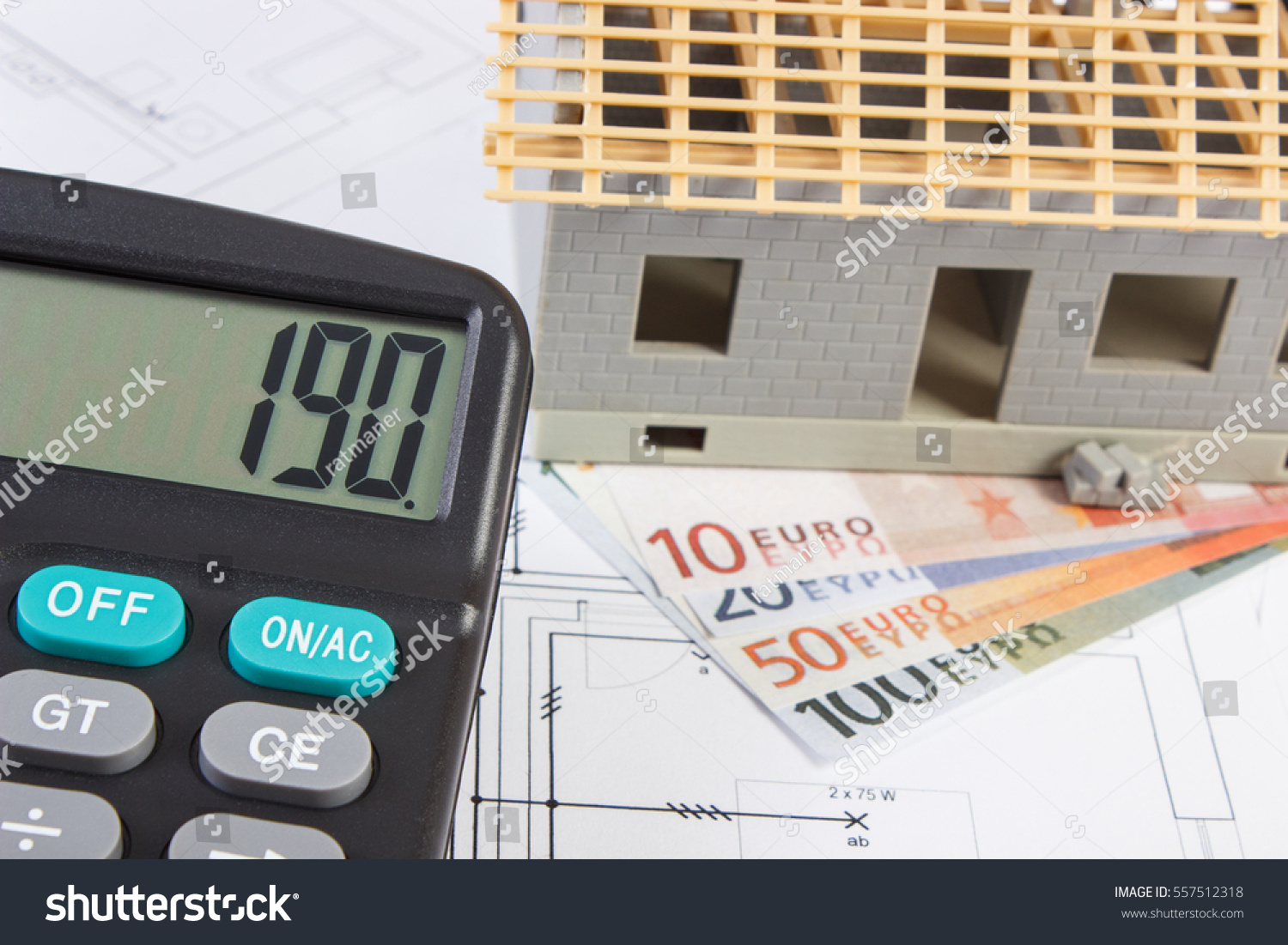Good House Construction Calculator #9: Small House Under Construction, Calculator And Currencies Euro On  Electrical Drawings For Project, Concept