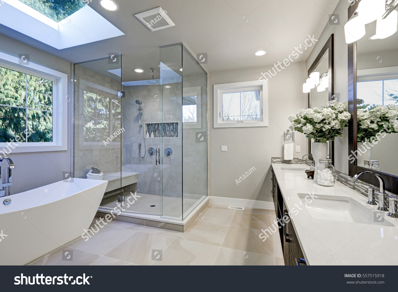 Heated rug bathroom - Spacious Bathroom In Gray Tones With Heated Floors Freestanding Tub Walk In Shower