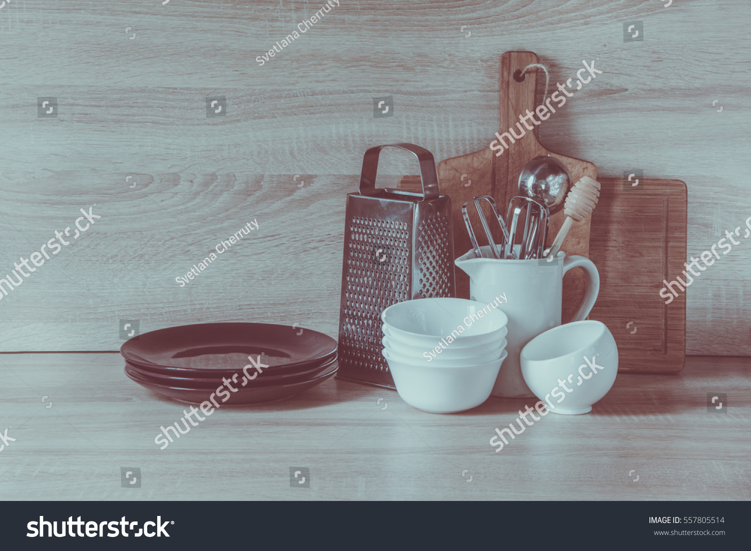 Crockery, tableware, utensils and other different stuff on wooden ...