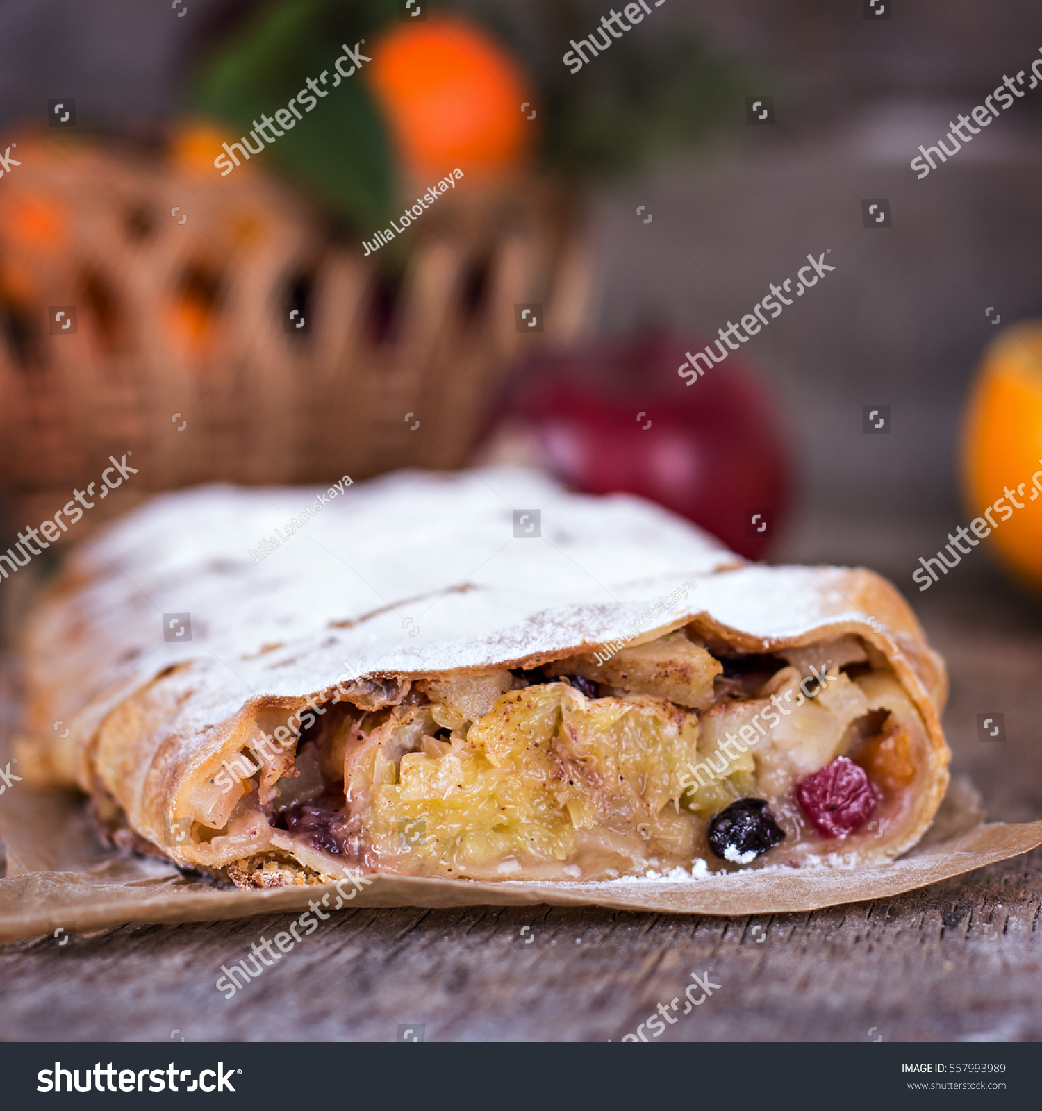 Apple strudel (pie) with oranges, cranberries, dried fruits, walnuts ...