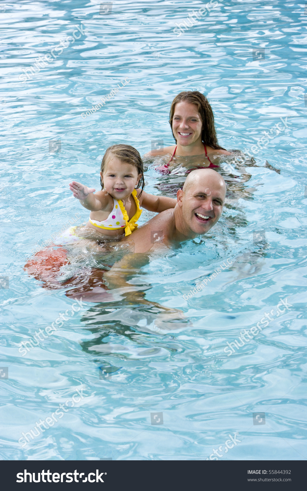 Family With 2 Year Old Girl Playing In Swimming Pool Stock Photo 55844392 Shutterstock