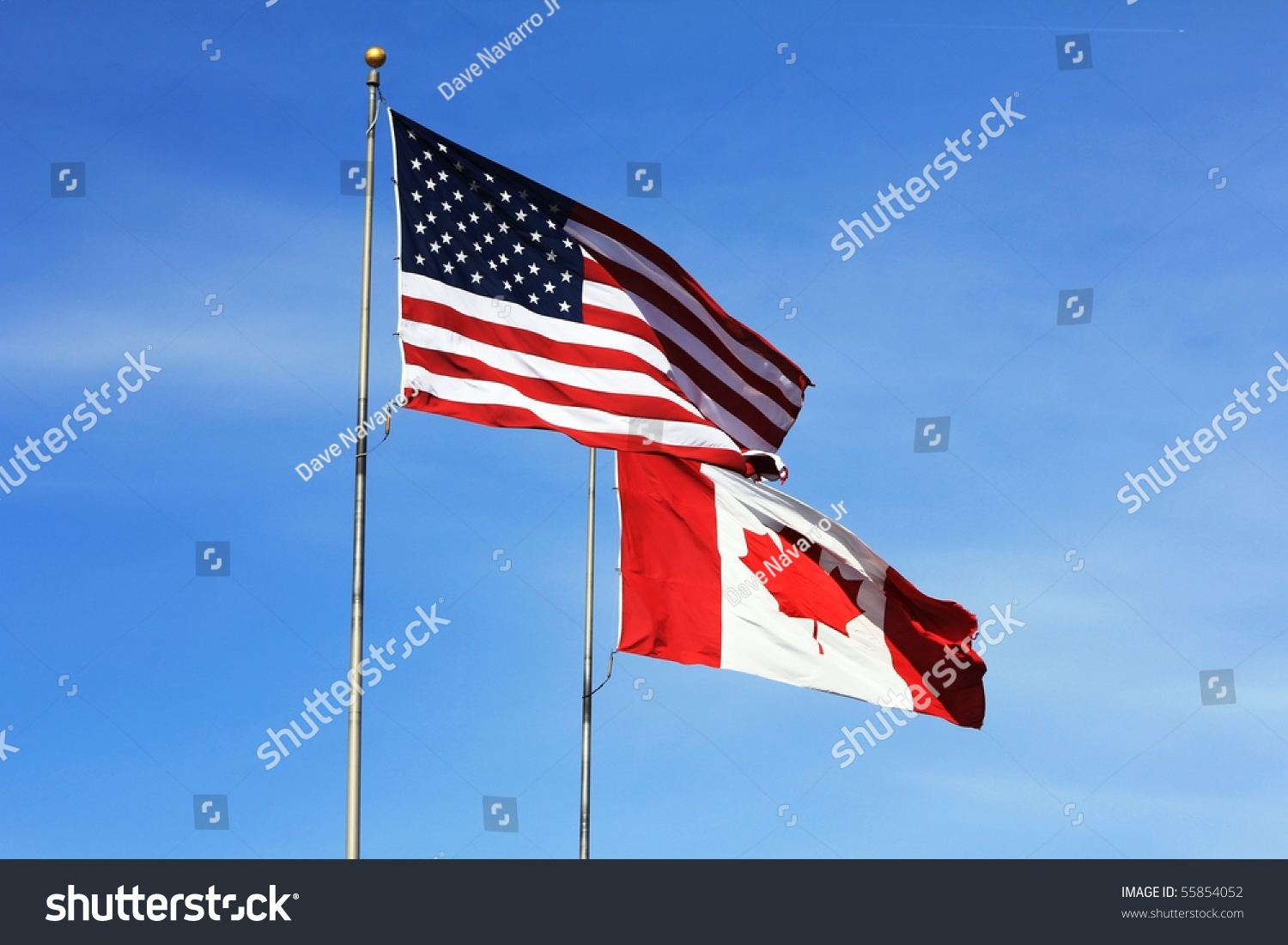 American Canadian Flags Flying Side By Stock Photo ...