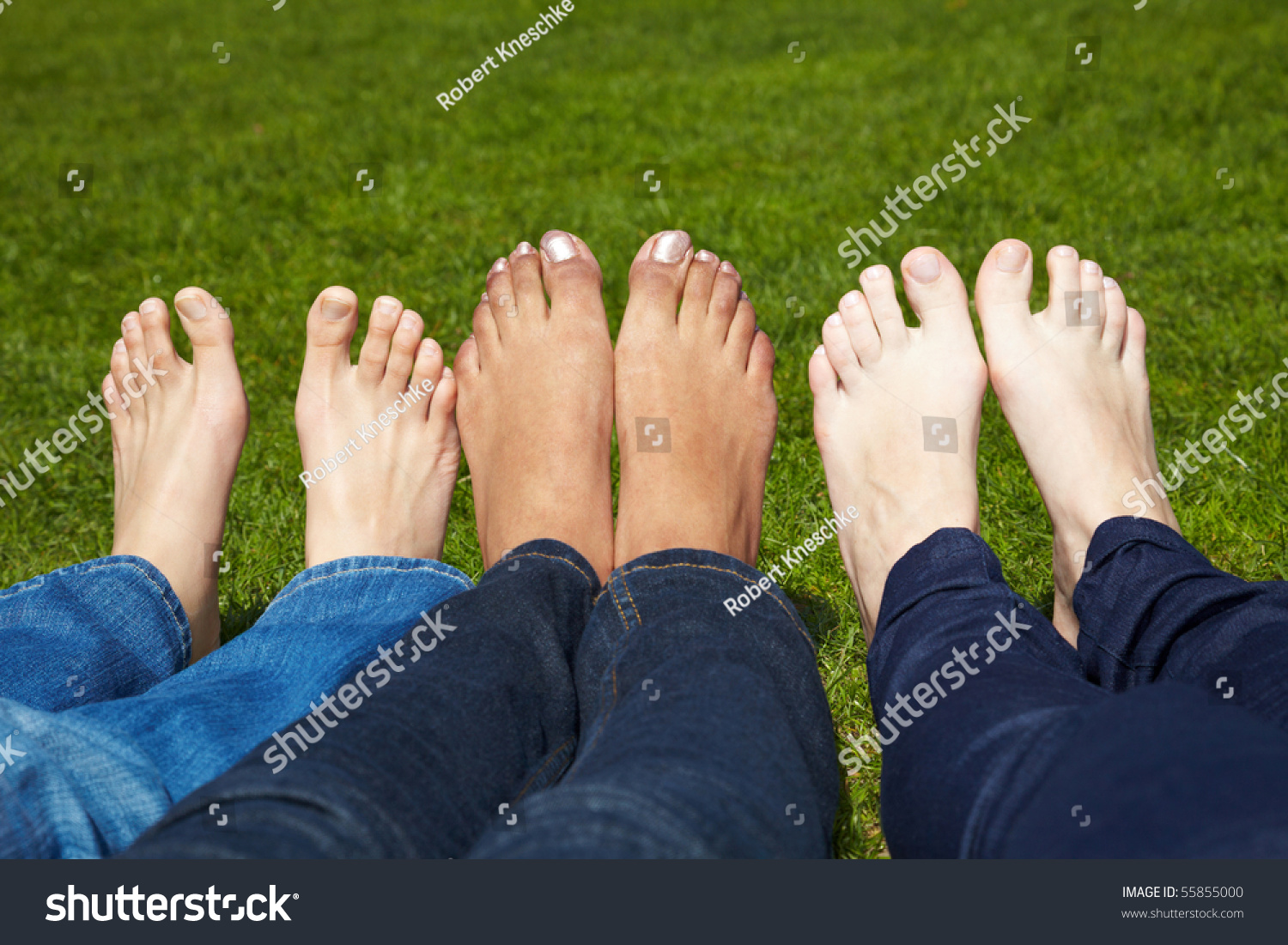 three women naked feet lying grass stock photo (royalty free