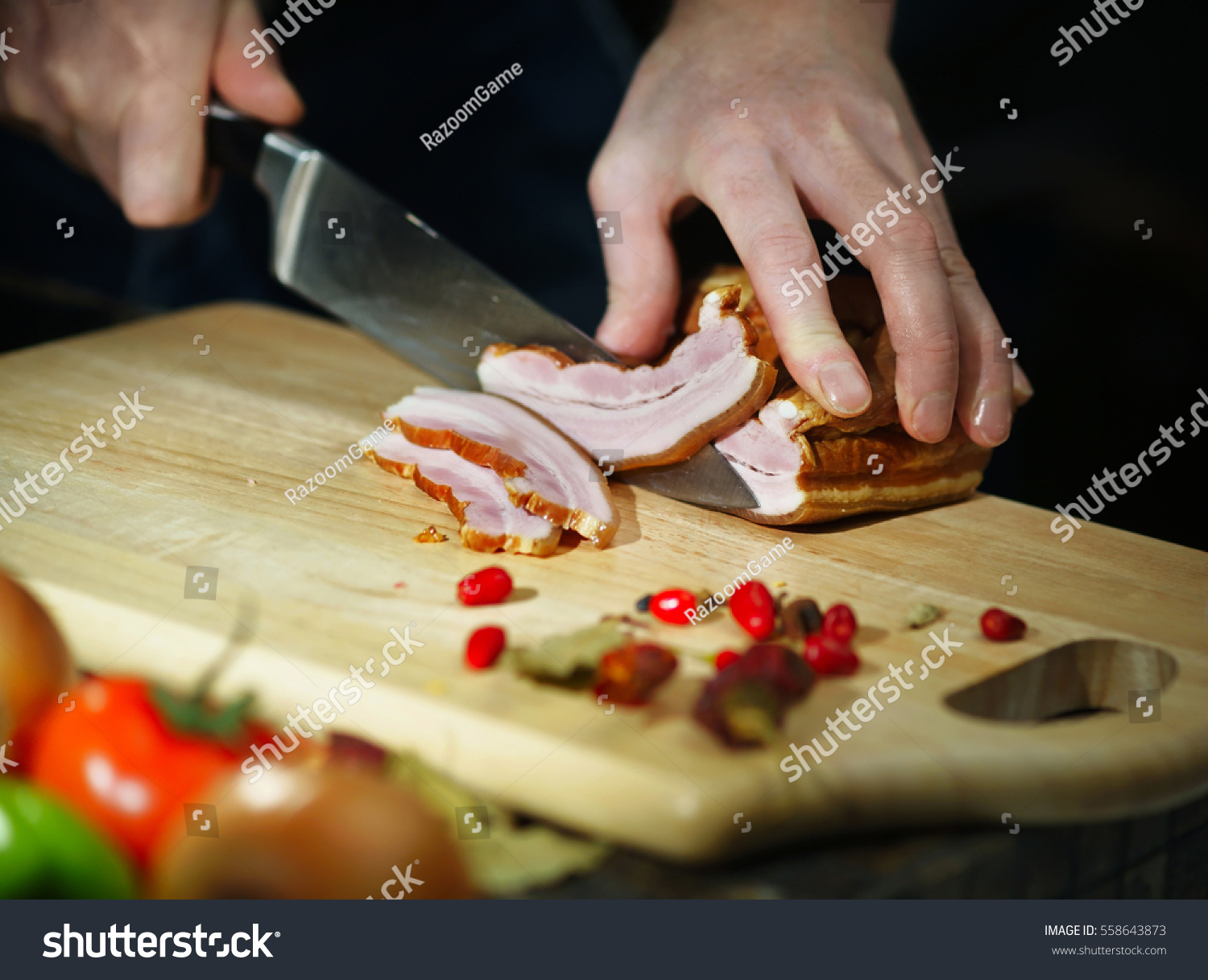 chef cuts smoked meat knife on stock photo 558643873 shutterstock. Black Bedroom Furniture Sets. Home Design Ideas