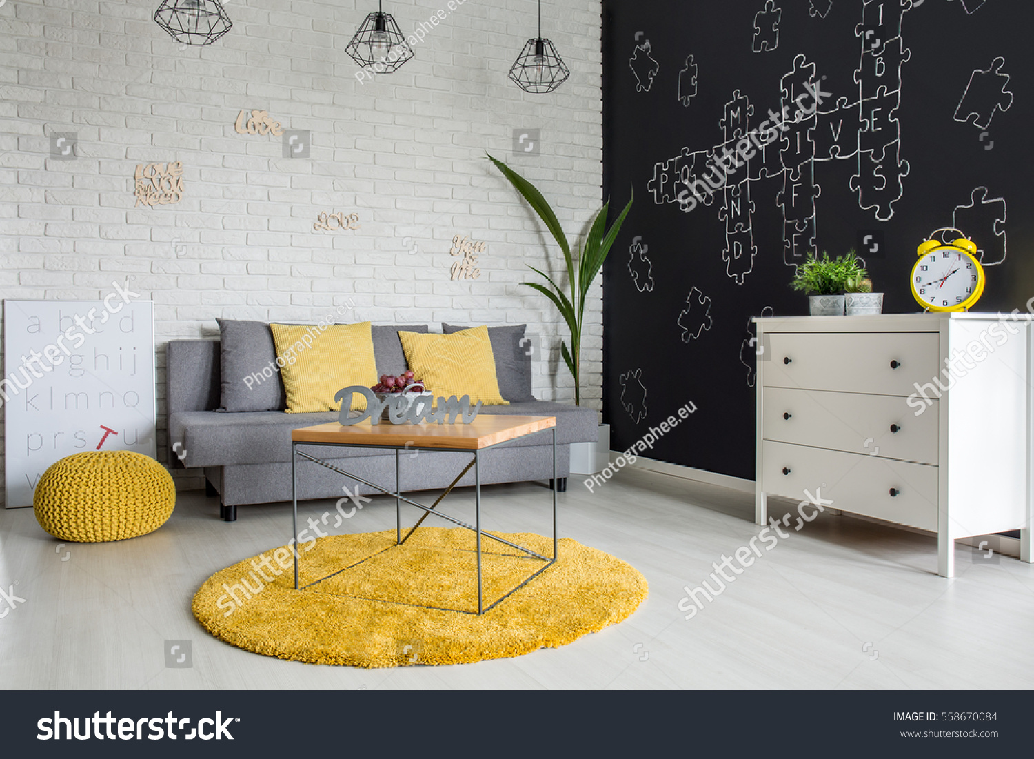 Room With Sofa Dresser Blackboard Wall And Yellow Details