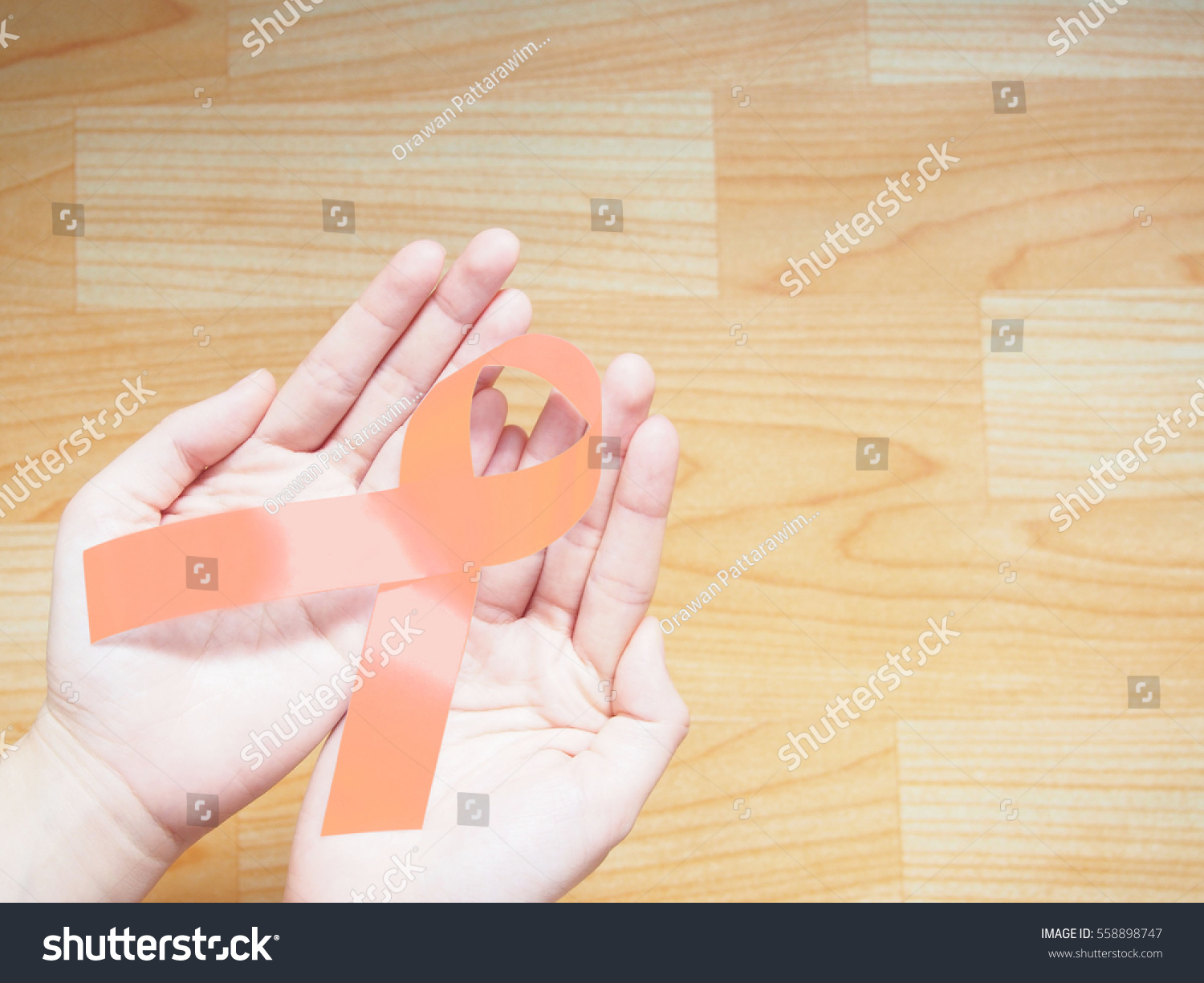 Female hands holding peach ribbon endometrial stock photo female hands holding peach ribbon for endometrial cancer uterine cancer and vaginal cancer awareness on buycottarizona