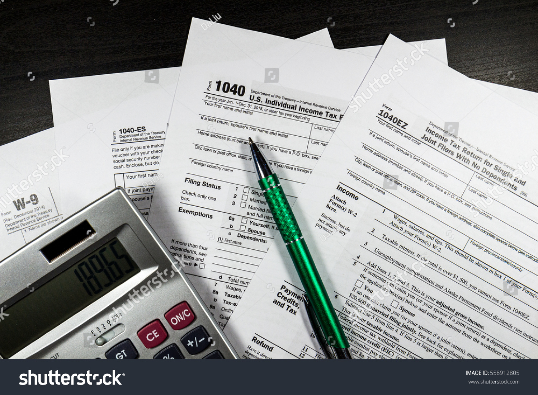 1040 tax return form pen stock photo 558912805 shutterstock 1040 tax return form with a pen falaconquin