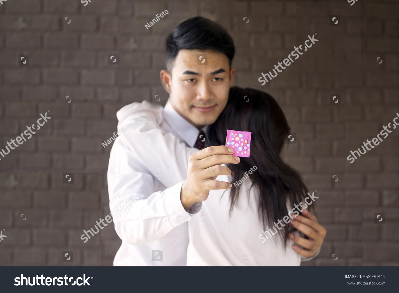 Handsome guy gets condom sex