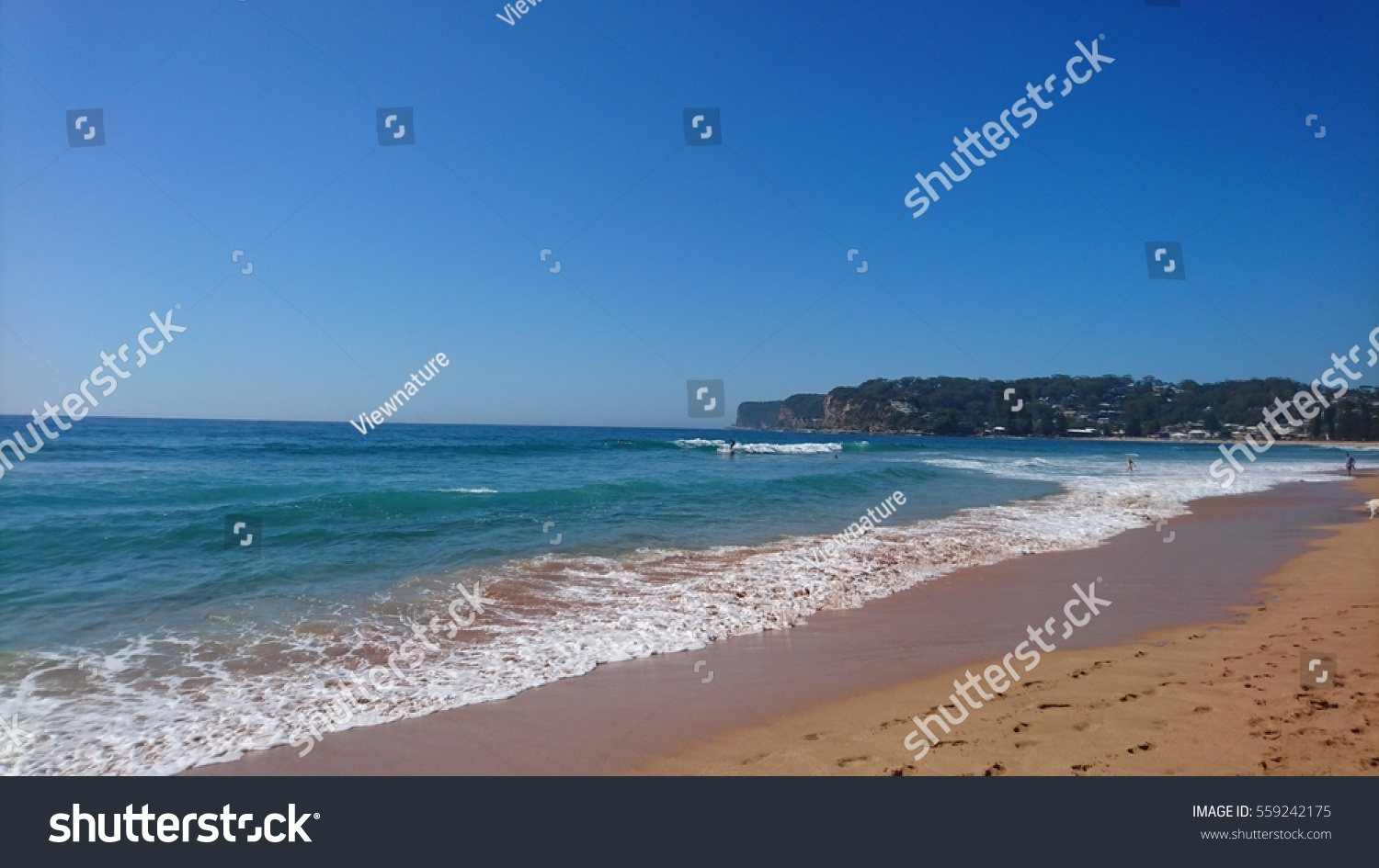 Rain Beach Emerald Coast Blue Sea Australia Ocean Summer: Shoreline Waves Blue Sky Headland Avoca Stock Photo