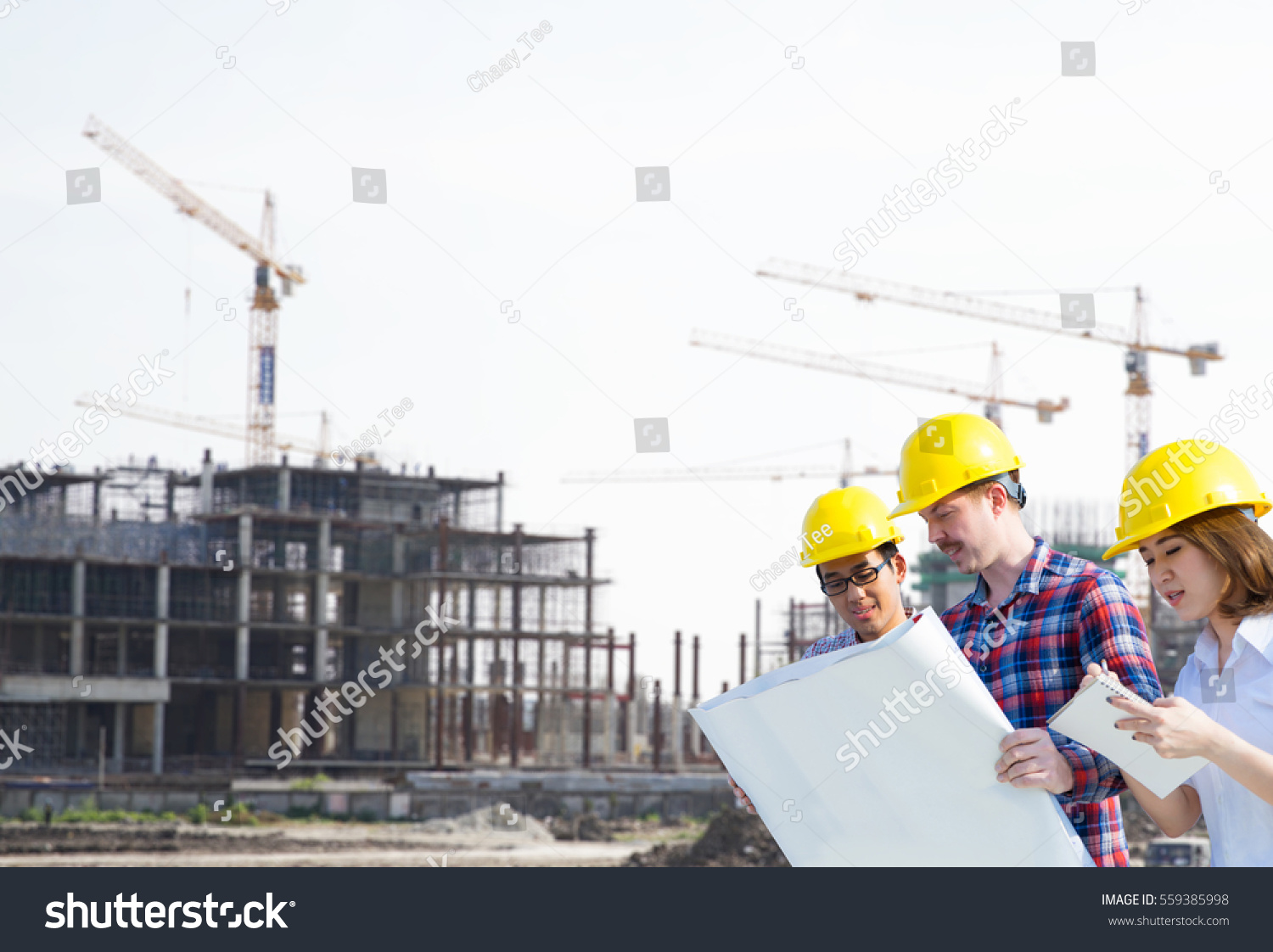 Engineer group worker meeting discussion construction stock photo engineer group and worker meeting discussion with construction blueprint on site work background malvernweather Images
