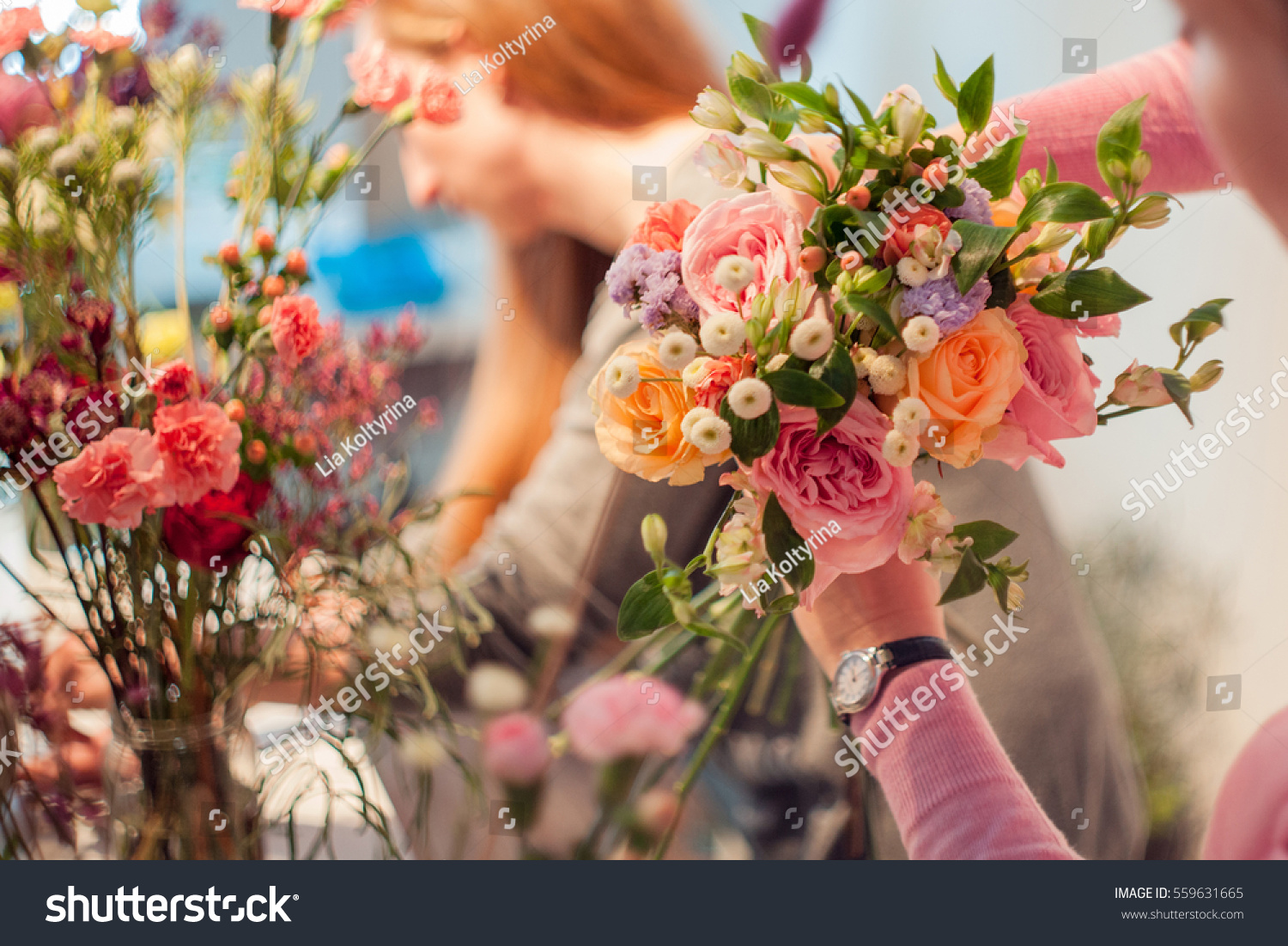 Workshop florist making bouquets flower arrangements stock photo workshop florist making bouquets and flower arrangements woman collecting a bouquet of roses izmirmasajfo