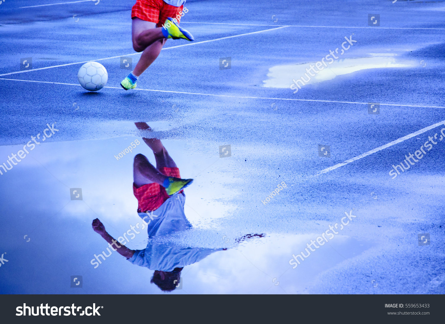 Young Football Player Kick To The Ball In Summer Rainy Evening Sport Active Wallpaper