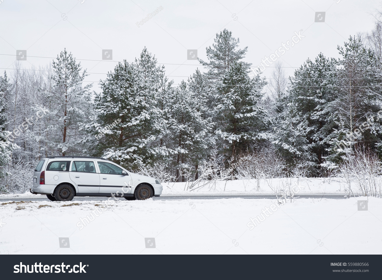 Car Driving Parking On White Snowy Stock Photo 559880566