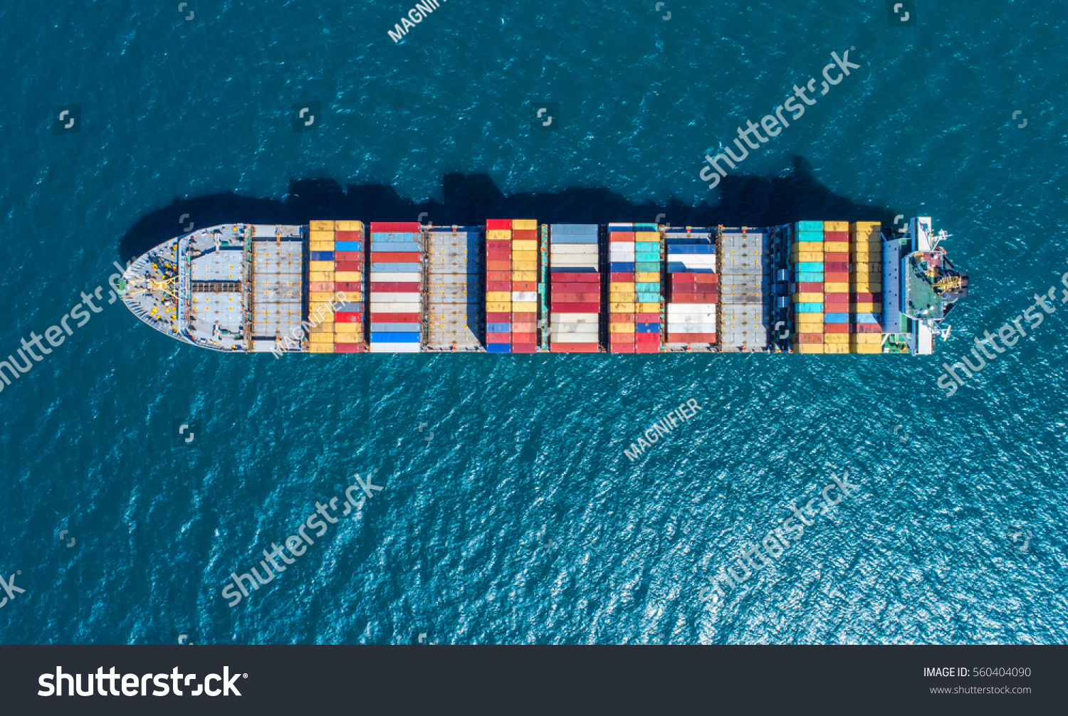 Container ship in export and import business and logistics. Shipping cargo to harbor by crane. Water transport International. Aerial view #560404090