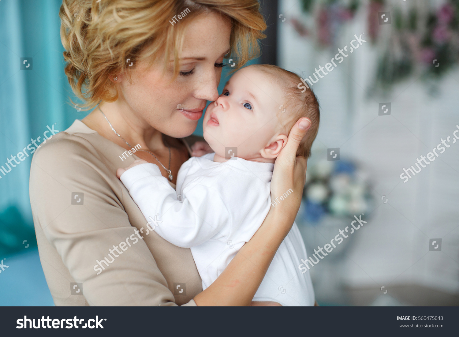 Young Mother Holding Her Newborn Child Stock Photo ...