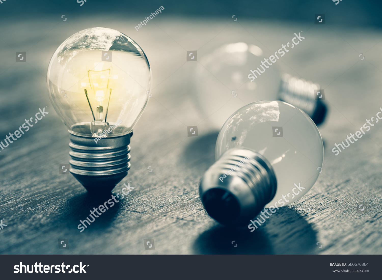 Small light bulb standing and glowing #560670364