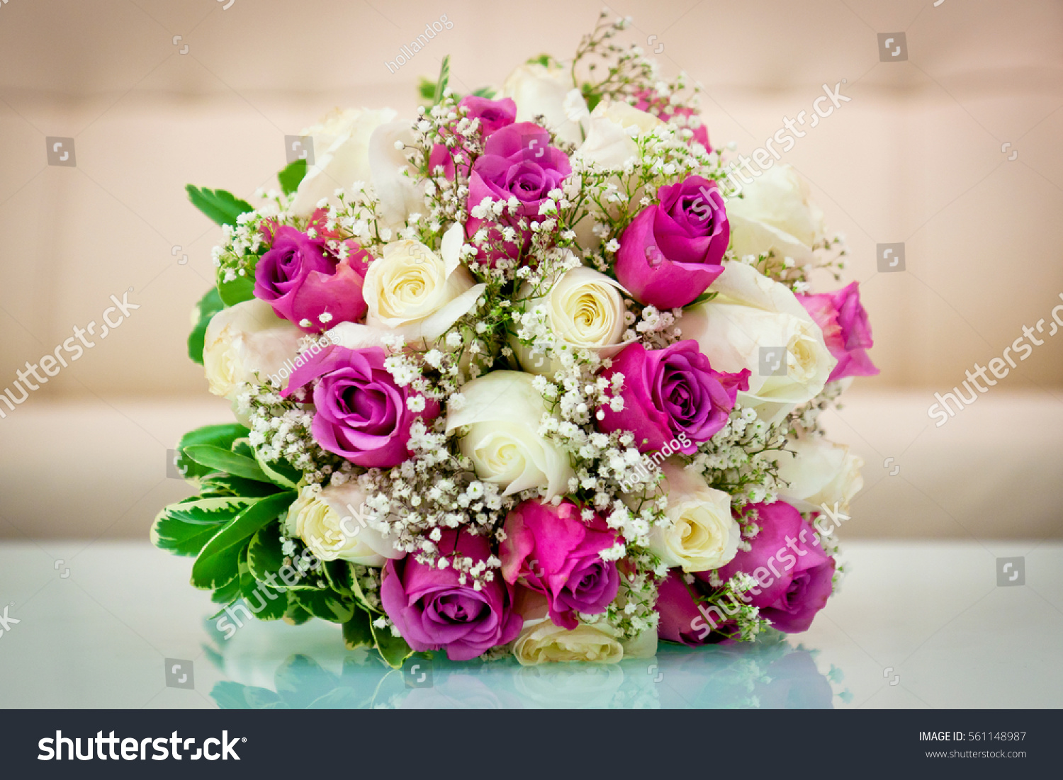 Closeup Of Brides Flowers On Wedding Day Are Pink And Purple Roses
