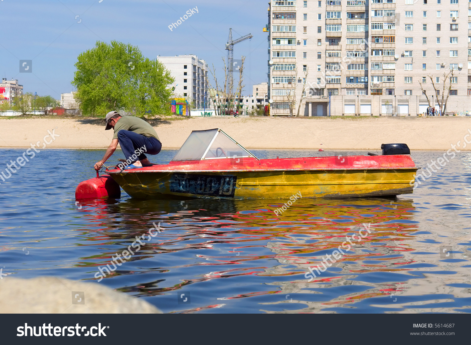 Man anchors his motor boat buoy stock photo 5614687 for Outboard motor repair near me