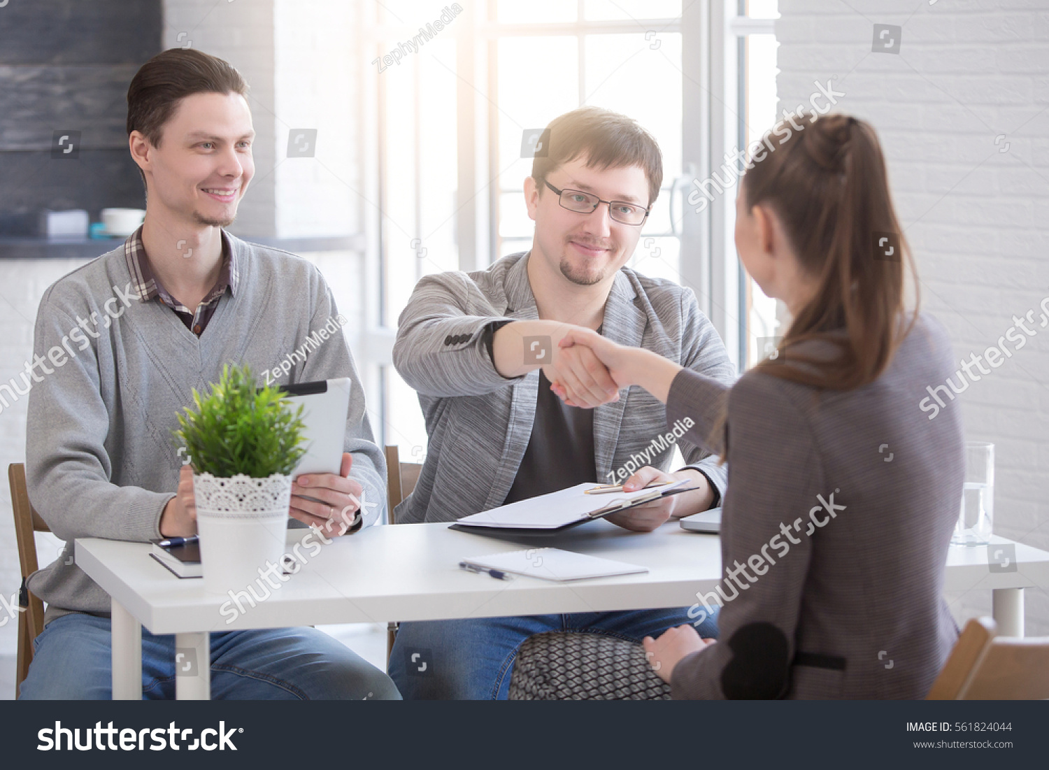 Business people handshake greeting deal at work photo free download - Young Woman Arriving For A Job Interview Business People Handshake In Modern Office Greeting