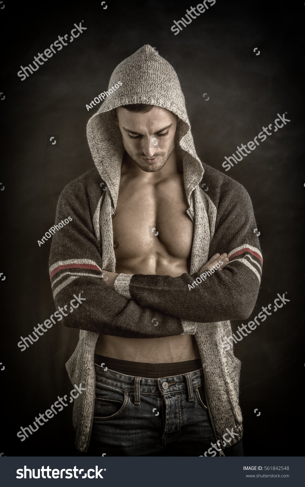 Confident, Attractive Young Man With Open Sweater On
