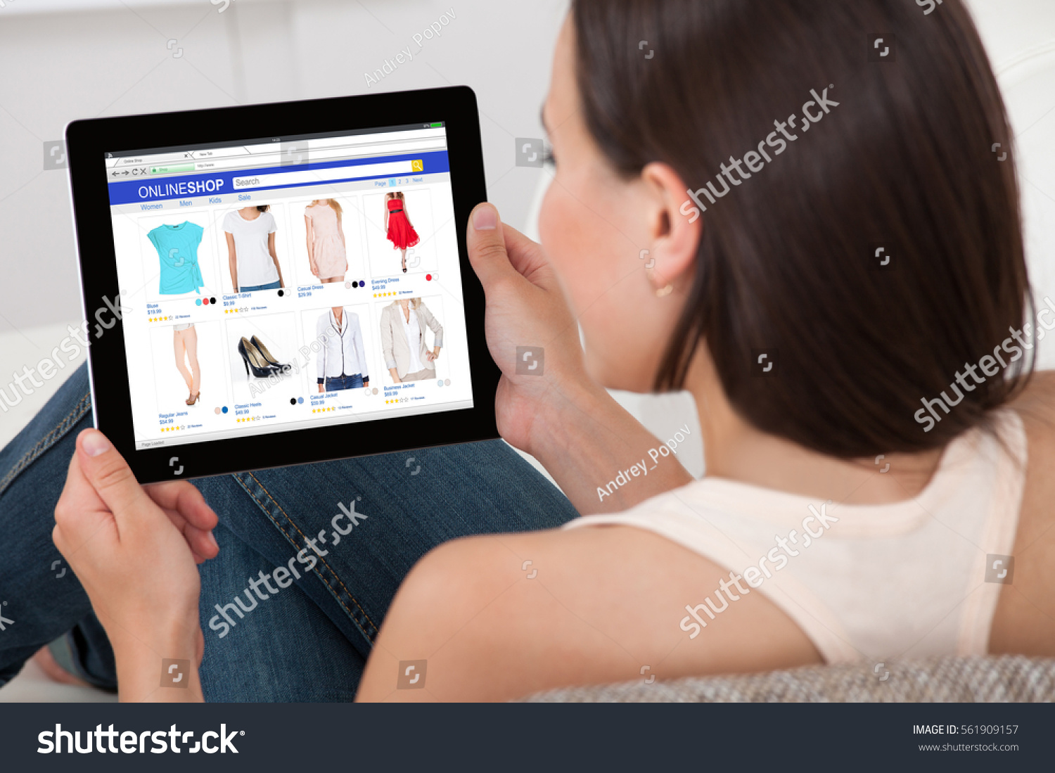 closeup woman doing online shopping on stock photo 561909157 shutterstock. Black Bedroom Furniture Sets. Home Design Ideas