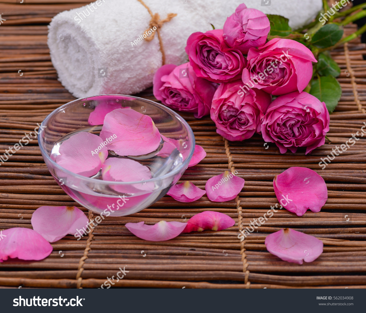 bouquet of pink roses,petals ,candle,towel on mat | EZ Canvas