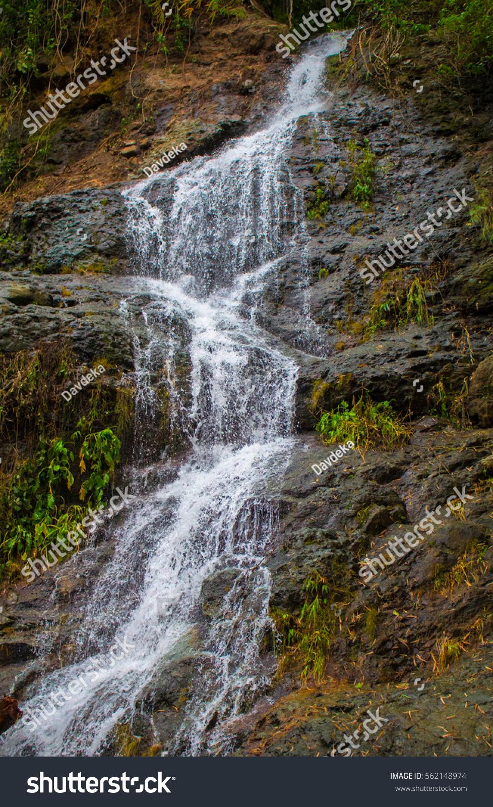 Tall waterfall on mountain waterfall stream stock photo for Waterfall environment