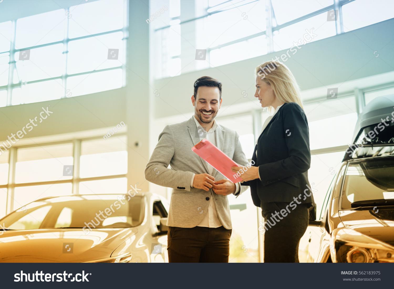 salesperson selling cars car dealership stock photo 562183975 shutterstock. Black Bedroom Furniture Sets. Home Design Ideas