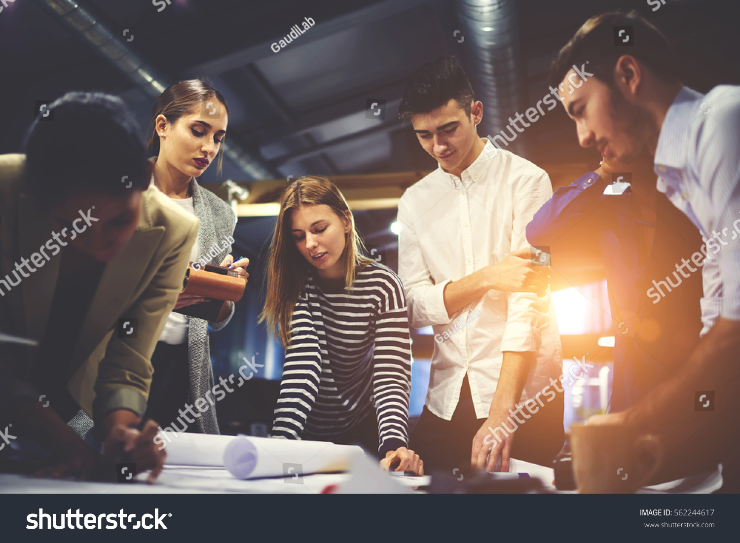 Crew young male female architects creating stock photo 562244617 crew of young male and female architects creating blueprint for modern constructed building consulting with skilled malvernweather Choice Image