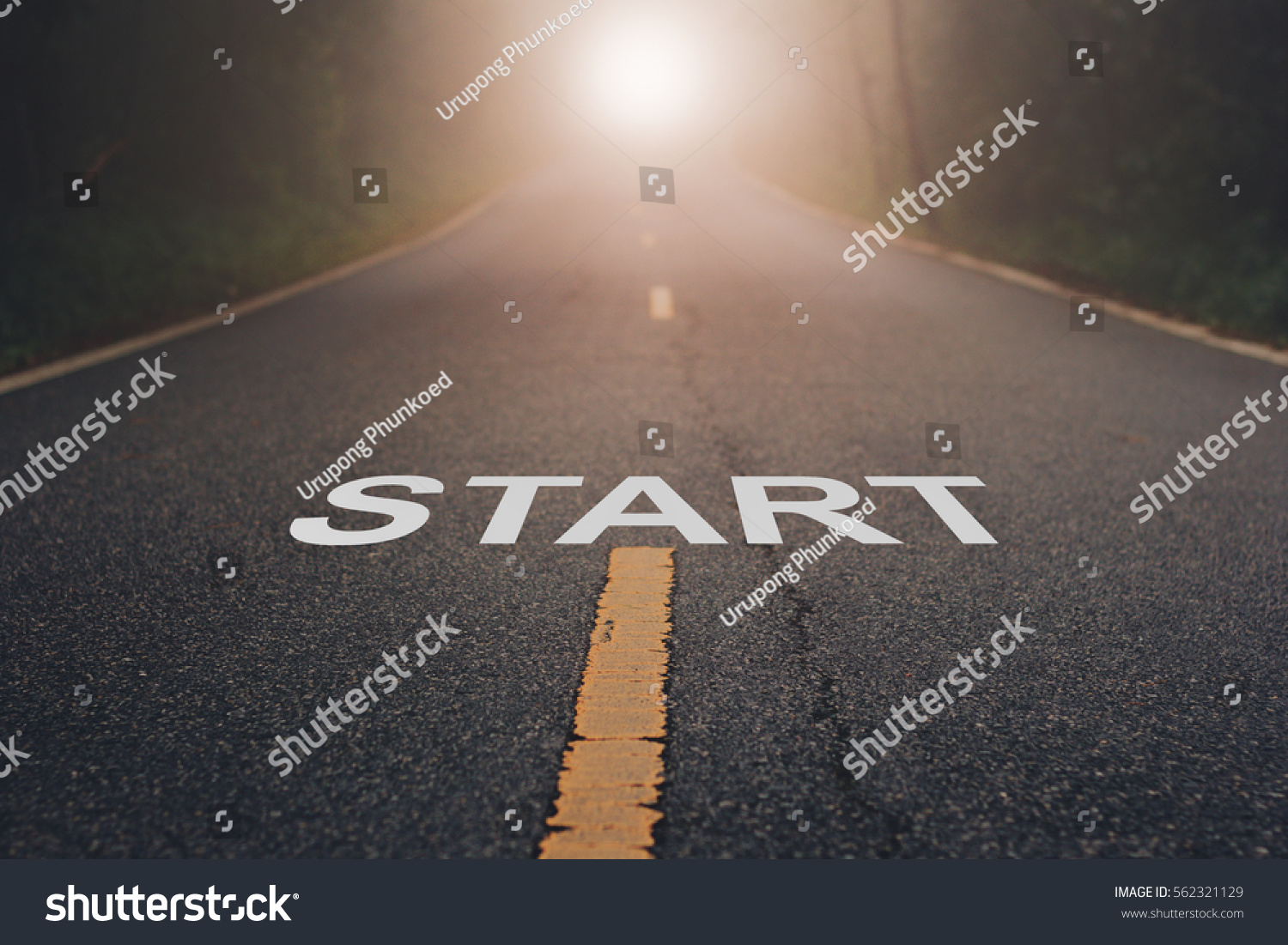 Conceptual image with word start on asphalt road   / Start Your Life  #562321129