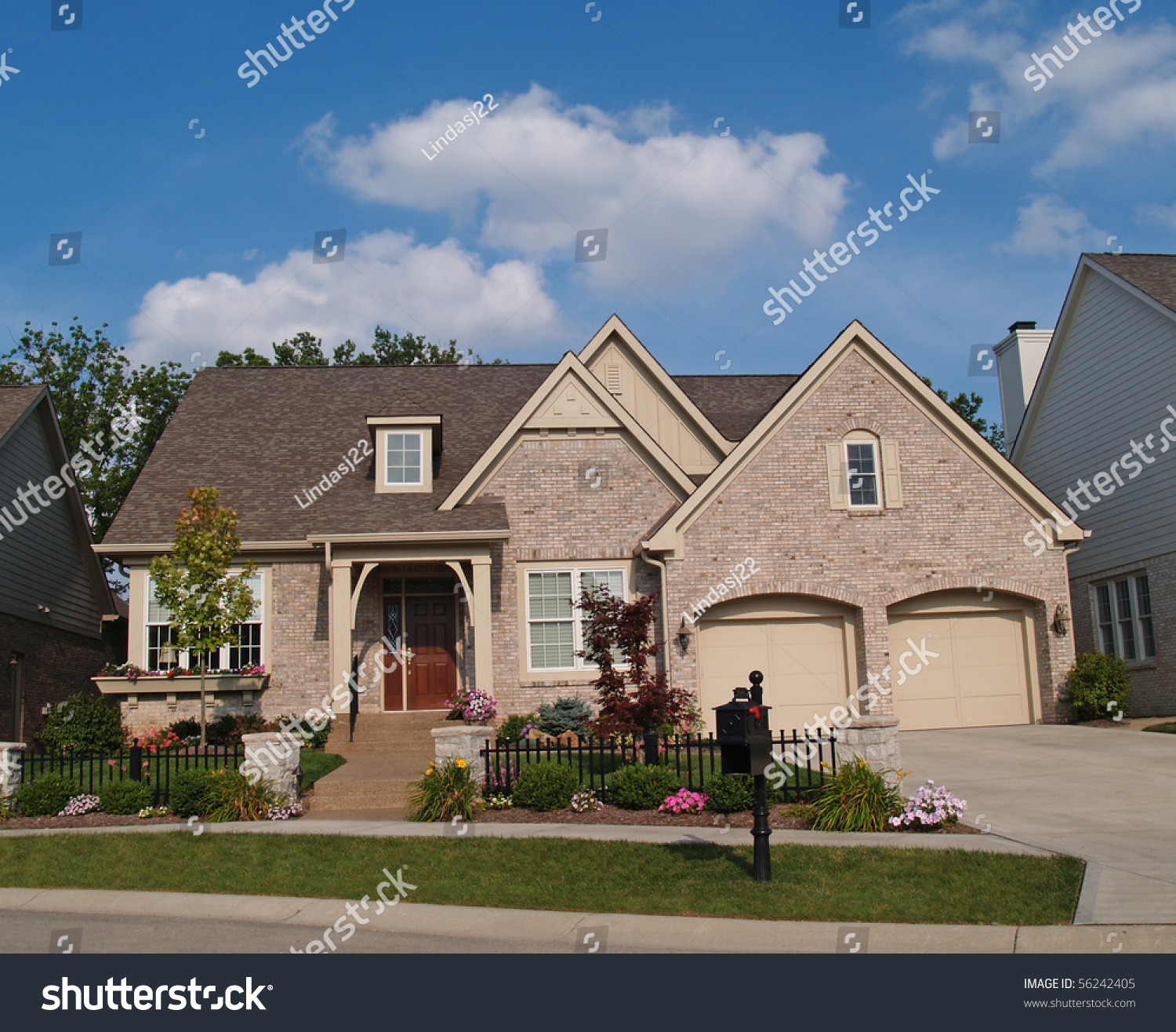 Small beige brick home with a two car garage in the front for Small two car garage