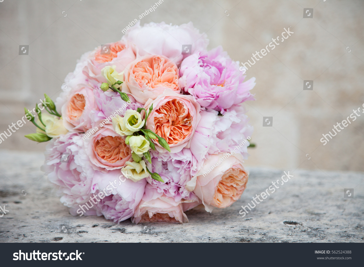 Wedding Bouquet From Orange Roses Pink Peonies And Cream Flowers