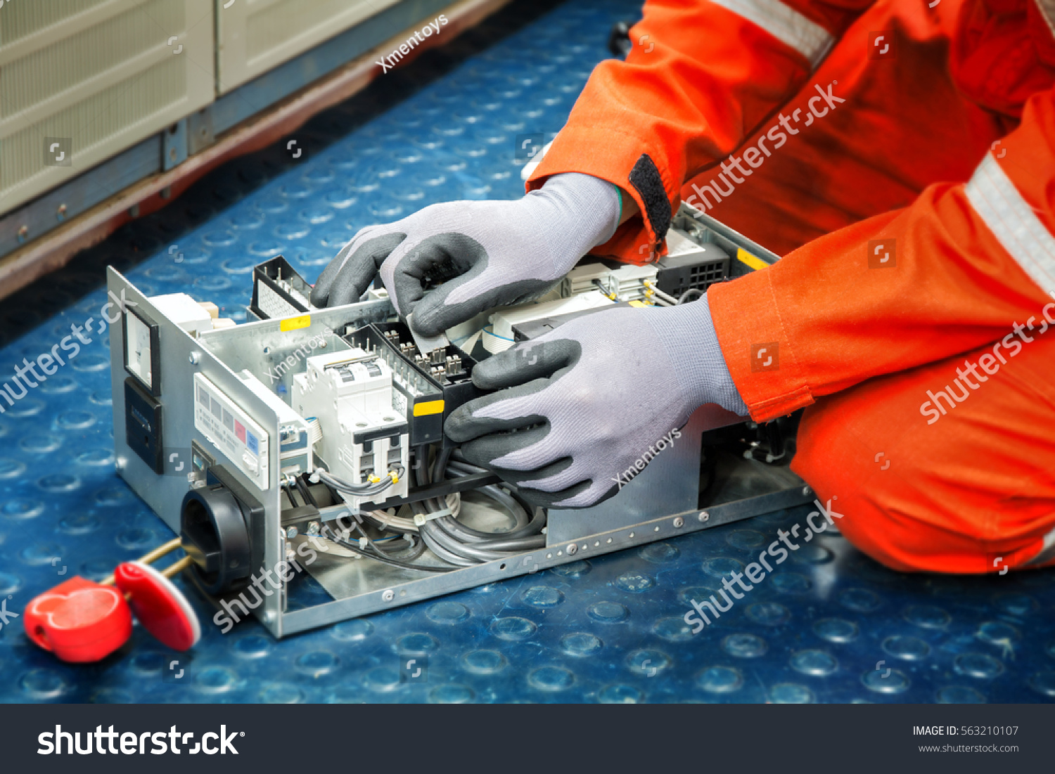 Hands of electricianduring clean up switching electric actuator equipment  in fuse box